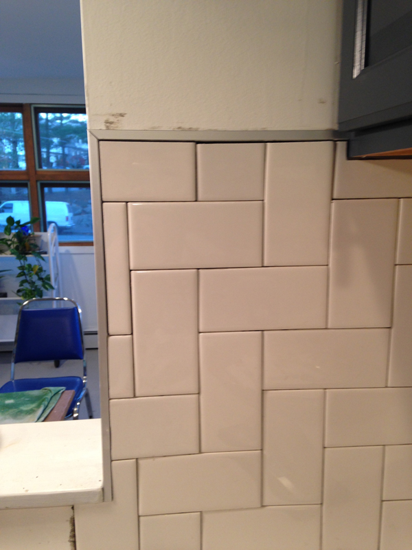 not your trendy grandmother s herringbone backsplash